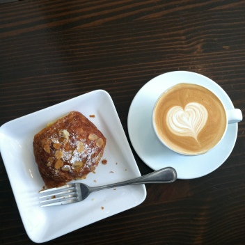 Almond croissant and cappuccino